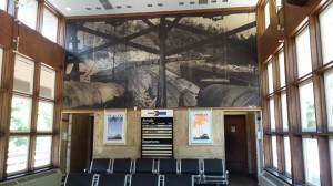 The back wall of the station is a huge old photograph.  Notice the arrivals and departures board...